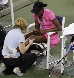 Venus Williams, of the United States, has her knee checked during her match against Vera Dushevina, of Russia. AP