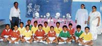 Achievers: Students of the St Anne's Higher Primary School who won many prizes at the City-level Schools' Sports Meets held in Kolar recently posing with school staff. DH photo