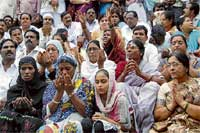 For the Leader: Congress workers pray for Chief Minister Y S Rajasekhar Reddy as his chopper goes missing in Hyderabad on Wednesday. PTI