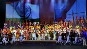 Folk artists from India stand together to thank the audience for the huge round of applause at the end of the concert. AP