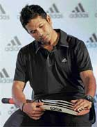 Time For A Knock: Sachin Tendulkar checks out a bat after launching Adidas cricket gear in Mumbai on Friday. AFP