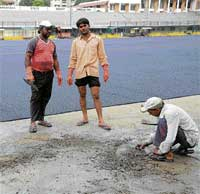 Sticky Time: Work on at the Karnataka State Hockey Association stadium to lay a new artificial turf. DH photo
