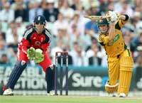 Australia's Michael Clarke, right, hits a ball from England's Adil Rashid at the Oval. AP