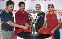 Cricketer Gautam Gambhir (right) unveils the Mantri Karnataka Premier League trophy at the Chinnaswamy stadium on Saturday. Also seen are chairman and managing director of Mantri Developers, Sushil Mantri (left), Transport Minister, R Ashok , and KSCA secretary, Brijesh Patel, (second from right). DH PHOTO