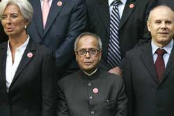 Finance minister Pranab Mukherjee (center) flanked by French finance minister Christine Lagarde (left) and Brazil's finance minister Guido Mantega at the G20 summit in London. AP