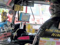 This autorickshaw is unique with a television, first aid kit, news magazines besides other information to make it more passenger friendly
