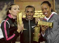 Yelena Isinbayeva (left), Kenenisa Bekele (centre) and Sanya Richards pose after winning the $1 million jackpot at the Brussels Golden League on Friday. AP