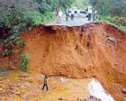 A mini water fall flowing down the trench after Kalasa-Karkala highway was damaged after landslide at Kudremukh. dh photo
