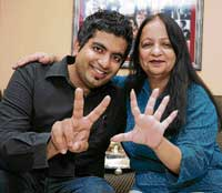 Advani's mother Kajal (right) and brother Shree shows how many world titles he has won so far. DH photo