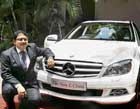 first class Mercedes India Director (sales & marketing) Debashish Mitra with the new special edition C-class in Bangalore on Tuesday. DH Photo