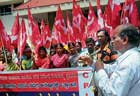 CPM activists staging a protest in front of MCC in Mangalore on Tuesday. DH photo