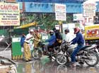 Confusion: Motorcyclists arguing with police at Anil Kumble Circle as road was closed for ongoing Metro Rail project work in Bangalore on Monday.  DH Photo