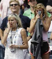 Leslie Oudin, bottom left, mother of Melanie Oudin, and Melanie Oudin's sister Katherine, right, weep in the player's family and friends box after the upset win. AP