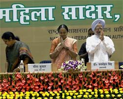 Prime Minister Manmohan Singh with Lok Sabha Speaker Meira Kumar, and MoS Purandeswari Devi (L) at the launch of 'Saakshar Bharat' on International Literacy Day in New Delhi on Tuesday. PTI