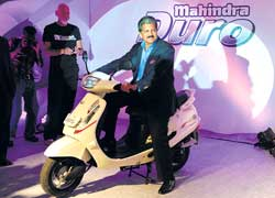 Mahindra Group Vice-Chairman & MD Anand Mahindra posing with the 'Duro' in Mumbai on Thursday. AFP