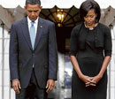 In remembrance: US President Barack Obama and first lady Michelle  take part in a moment of silence marking the eighth anniversary of the September 11 attacks on New York, Washington, and Pennsylvania, on the South Lawn at the White House in Washington on Friday. REUTERS