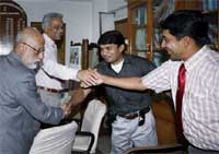Jet Airways Executive Director Saroj K Datta (L) and CEO Hafiz Ali (2nd L) shaking hands with the two sacked pilots before a meeting with Chief Labour Commissioner, in New Delhi. PTI