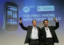 Sanjay Jha, right, co-CEO of Motorola Inc., and CEO of Motorola Mobile Devices, and Cole Brodman, left, T-Mobile Chief Technology Innovation Officer, holds up a new mobile device based on Google's Android operating system. AP