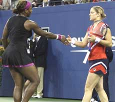 Serena Williams, (left) of the United States, shakes hands with Kim Clijsters, of Belgium, after losing the match at the U.S. Open tennis tournament in New York. AP