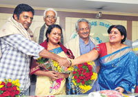 CONGRATULATIONS:National award winner Prakash Rai being congratulated by Karnataka Film Chamber of Commerce President Jayamala in Bangalore on Saturday. Umashree, Girish Kasaravalli, Basantkumar Patil and senior director Tiptur Raghu (in the background) are also seen. DH Photo