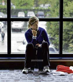 Kim Clijsters sits in the players' lounge for the rain to abate at the US Open in New York on Friday. AFP