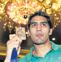 SHOWING OFF! Vijender Singh holds aloft his boxing World Championship bronze medal in Gurgaon on Monday. PTI