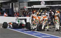 Force India driver Adrian Sutil of Germany gets a pit service during the Italian Formula One Grand Prix, at the Monza racetrack, Sunday