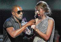 Singer Kanye West takes the microphone from singer Taylor Swift as she accepts the 'Best Female Video' award during the MTV Video Music Awards in New York on Sunday night. AP