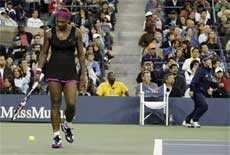 A line judge leaves her chair to report an argument with Serena Williams, left, of the US, during her match against Kim Clijsters. AP