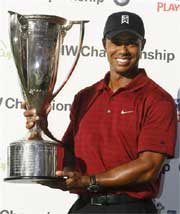 Tiger Woods holds the J.K. Wadley trophy after winning the BMW Championship golf tournament in Lemont, Ill., AP