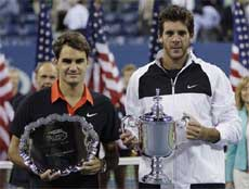Roger Federer, left, of Switzerland, and Juan Martin del Potro, of Argentina, pose with their trophies. AP
