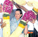 Congress workers garland party president Sonia Gandhi during the inauguration of the newly renovated Mumbai Congress office in Mumbai on Monday. PTI