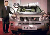 EXCITING 'X' TRAIL: Nissan Motor India CEO & Managing Director Kiminobu Tokuyama launching the new Nissan X-Trail, in Mumbai on Wednesday. PTI