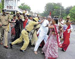 violence Police caning protesters in Gulbarga on Tuesday. DH photo