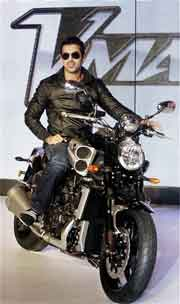 Bollywood actor John Abraham poses on a newly launched Yamaha VMax at an event in New Delhi. PTI