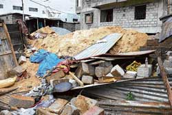 A wall collapsed at the workers shed at Kammasandra, Hebbagudi in Bangalore on Wednesday. DH Photos