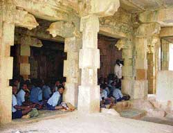 Classes being held inside the Virupakshewara temple at the  Virupakshi village. DH photo