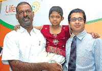 Thamirabharuni (centre)with her father Senthil Kumar (left) and Mayur Abhaya, Executive Director, LifeCell International, in Chennai on Wednesday. DH photo