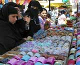 Muslim women purchase bangles ahead of Id-ul-fitr in Karad, Maharashtra on Thursday.