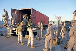 Strategic Importance: US Marines with 8th Combat Logistics Battalion unload packs at Manas air base, Kyrgyzstan, as they prepare for deployment in Afghanistan. NYT