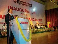Saraswat Bank Chairman E K Thakur addressing the gathering at the inaugural of four branches of the Bank in Mangalore on Saturday. DH photo