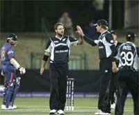 New Zealand players celebrate after Indian captain Mahendra Singh Dhoni was caught out while Indian player Suresh Raina looks on. AP