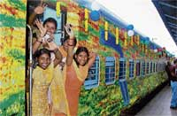 'Maiden' Journey: Girls wave as they board the Chennai Central-Hazrat Nizamuddin weekly non-stop Duronto Express after it was flagged off from the Central Station in Chennai on Monday. PTI