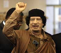 Libyan leader Muammar Gaddafi gestures as he enters the U.N. headquarters for the United Nations General Assembly on Wednesday. AFP