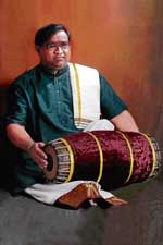 H S Sudhindra on the mridangam.