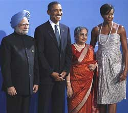 US President Barack Obama and first lady Michelle Obama welcome Indian Prime Minister Manmohan Singh and wife Gursharan Kaur, as they arrive for the G-20 summit dinner in Pittsburgh on Thursday. AP