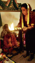 Aarti being performed at a household.