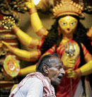 A priest prepares to worship Durga in Kolkata. AFP
