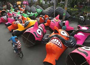 Effigies of demon God Ravan, being prepared for the upcoming Dussehra festival in New Delhi on Thursday. AP
