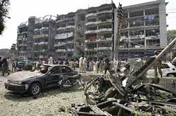 Security officials gather at the site of bomb blast in Peshawar on Saturday. AP